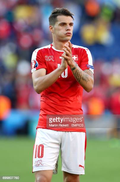 Switzerland's Granit Xhaka applauds the fans after the final whistle