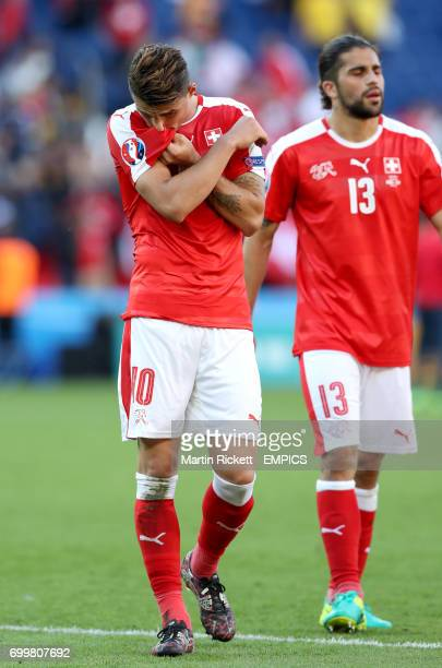 Switzerland's Granit Xhaka dejected after the final whistle