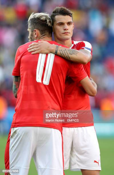 Switzerland's Granit Xhaka hugs Valon Behrami after the final whistle