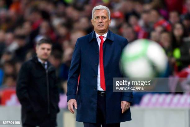 Switzerland's head coach Vladimir Petkovic looks at the ball in front of Latvian head coach Marians Pahars during the WC 2018 qualifying football...
