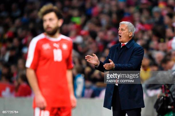 Switzerland's head coach Vladimir Petkovic reacts behind Swiss forward Admir Mehmedi during the WC 2018 qualifying football match Switzerland vs...