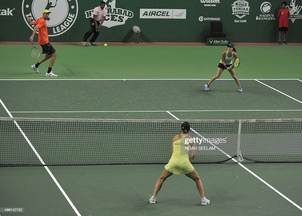 Switzerland's Hyderabad Aces Martina Hingis looks on as partner Croatian Ivo Karlovic plays a shot during their mixed doubles match against Serbia's...