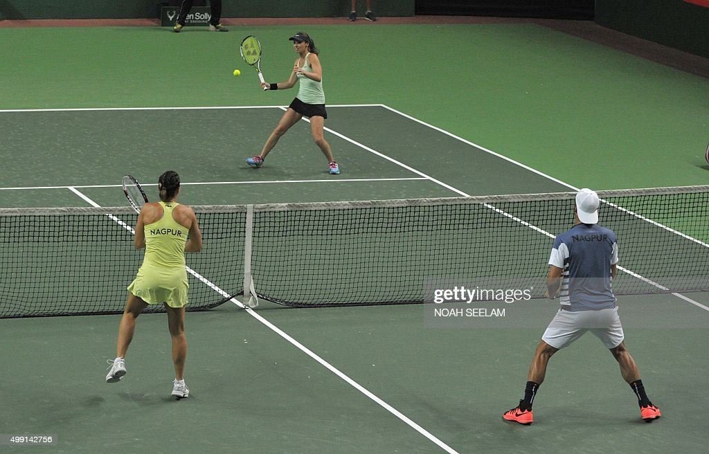 Switzerland's Hyderabad Aces Martina Hingis plays a shot during a mixed doubles match against Serbia's Jelena Jankovic and Spain's Feliciano Lopez of...