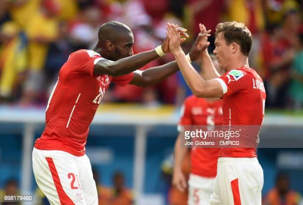 Switzerland's Johan Djourou celebrates with team mate Switzerland's Stephan Lichtsteiner