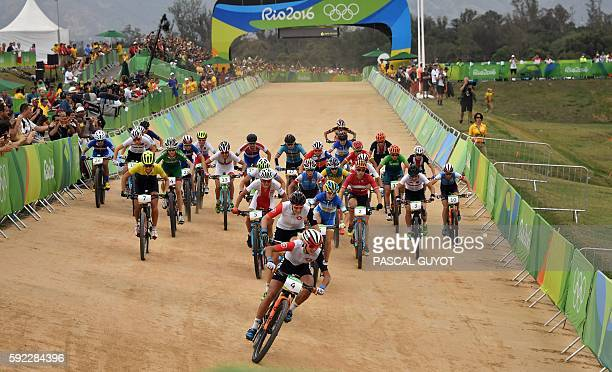 Switzerland's Jolanda Neff leads at the start of the cycling mountain bike women's crosscountry race of the Rio 2016 Olympic Games at the Mountain...
