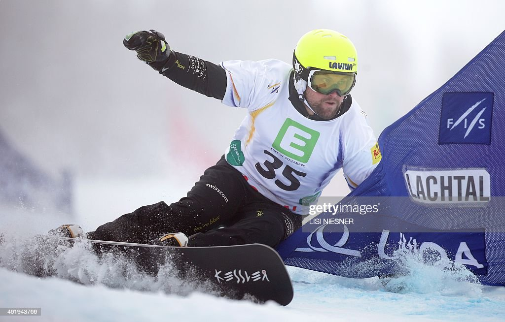 Switzerland's Kaspar Fluetsch competes during the Men's Snowboard Parallel Slalom qualification at the FIS Freestyle and Snowboarding World Ski Championships 2015 in Lachtal near Kreischberg, Austria on January 22, 2015. AFP PHOTO / LISI NIESNER