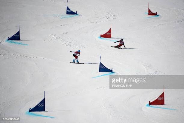 Switzerland's Ladina Jenny and Canada's Marianne Leeson compete in the Women's Snowboard Parallel Giant Slalom 1/8 Finals at the Rosa Khutor Extreme...
