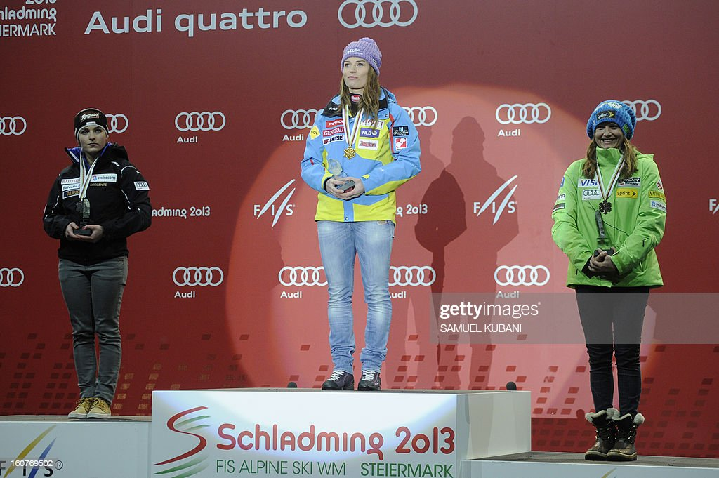 Switzerland's Lara Gut, Slovenia's Tina Maze and US Julia Mancuso stand on the podium after the women's Super-G event of the 2013 Ski World Championships in Schladming, Austria on February 5, 2013.