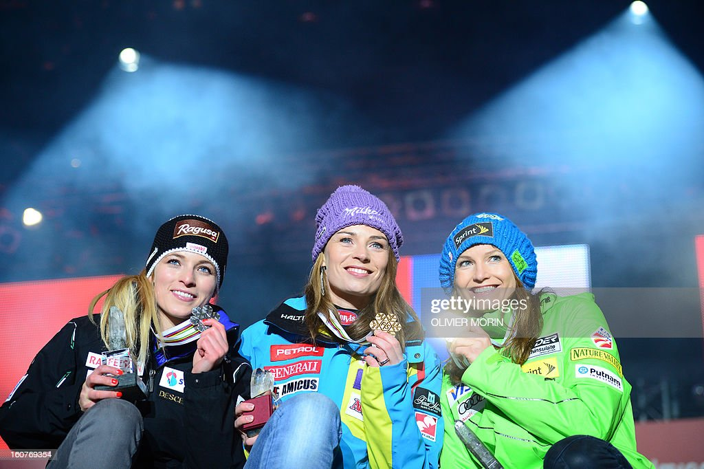 Switzerland's Lara Gut, Slovenia's Tina Maze and US Julia Mancuso celebrates with their medals after the women's Super-G event of the 2013 Ski World Championships in Schladming, Austria on February 5, 2013.