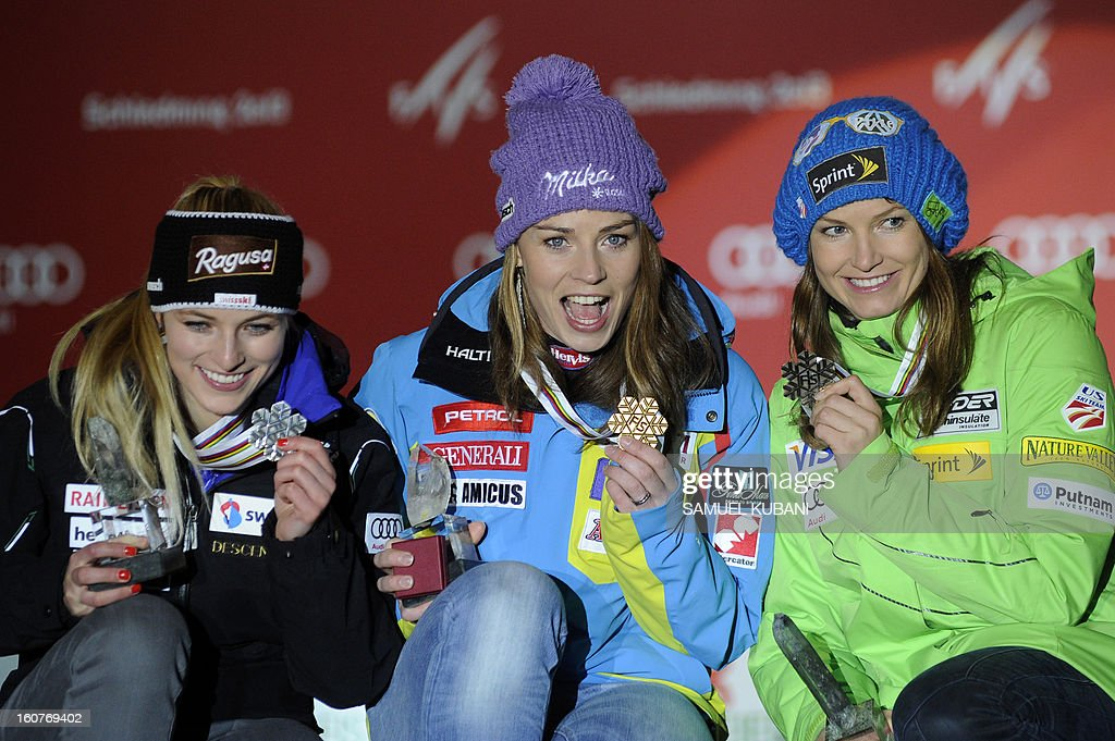 Switzerland's Lara Gut, Slovenia's Tina Maze and US Julia Mancuso celebrate with their medals after the women's Super-G event of the 2013 Ski World Championships in Schladming, Austria on February 5, 2013