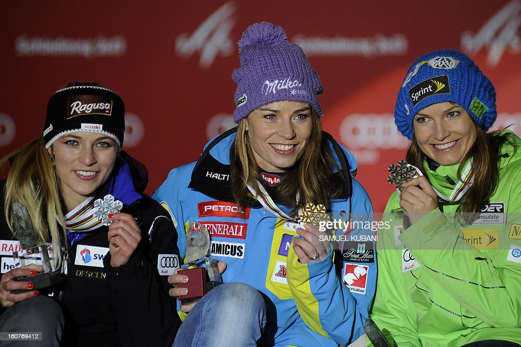 Switzerland's Lara Gut, Slovenia's Tina Maze and US Julia Mancuso celebrate with their medals after the women's Super-G event of the 2013 Ski World Championships in Schladming, Austria on February 5, 2013 AFP PHOTO / SAMUEL KUBANI