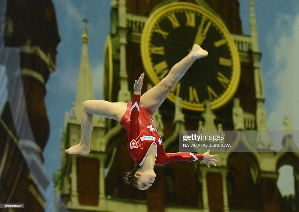 Switzerland's Laura Schulte competes on the balance beam against a huge photo of the Kremlin's Spasskaya (Saviour) Tower in the women's individual artistic gymnastics qualification during the 5th European Men's and Women's Artistic Gymnastic Individual Championships in Moscow on April 18, 2013. The 5th European Men's and Women's Artistic Gymnastic Individual Championships takes place in Moscow from April 17 to April 21.
