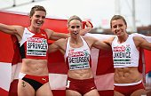 Switzerland's Lea Sprunger Denmark's Sara Slott Petersen and Poland's Joanna Linkiewicz pose together after competing in the women's 400m hurdles...