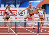 Switzerland's Lea Sprunger Denmark's Sara Slott Petersen and Poland's Joanna Linkiewicz compete in the women's 400m hurdles final during the European...