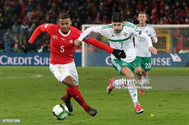 Switzerland's Manuel Akanji and Northern Ireland's Jordan Jones battle for the ball during the FIFA World Cup Qualifying second leg match at St Jakob...