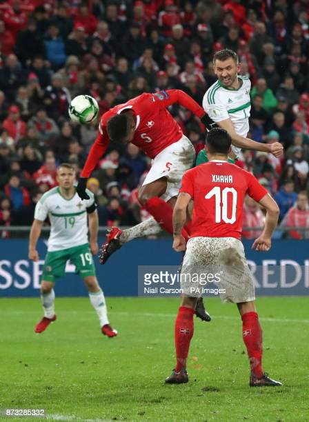 Switzerland's Manuel Akanji heads the ball clear from danger under pressure from Northern Ireland's Gareth McAuley during the FIFA World Cup...