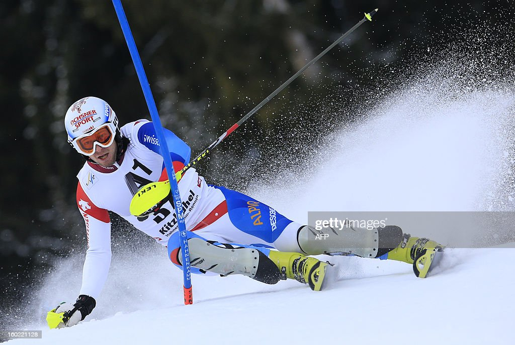 Switzerland's Marc Gini competes during the first round of the FIS World Cup men's slalom race on January 27, 2013 in Kitzbuehel, Austrian Alps.