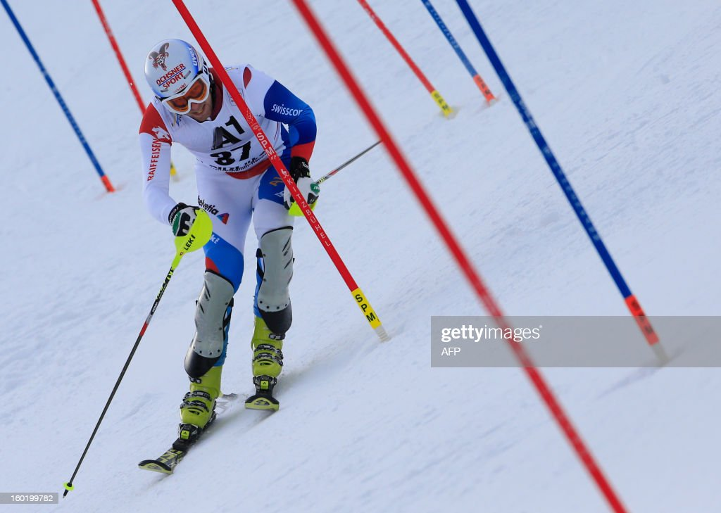 Switzerland's Marc Gini competes in the FIS World Cup men's slalom race on January 27, 2013 in Kitzbuehel, Austria.