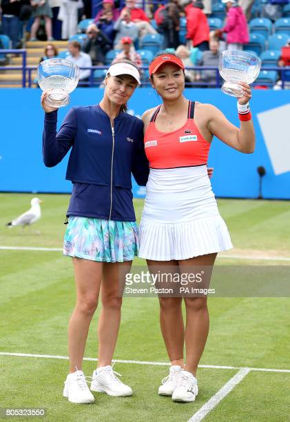 Switzerland's Martina Hingis and Chinese Taipei's Yungjan Chan celebrate with their trophies after winning against Australia's Ashleigh Barty and...