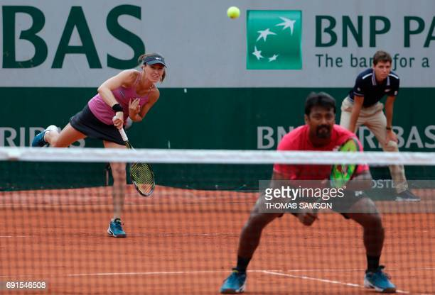 Switzerland's Martina Hingis and India's Leander Paes return the ball to Slovenia's Katarina Srebotnik and South Africa's Raven Klassen during their...