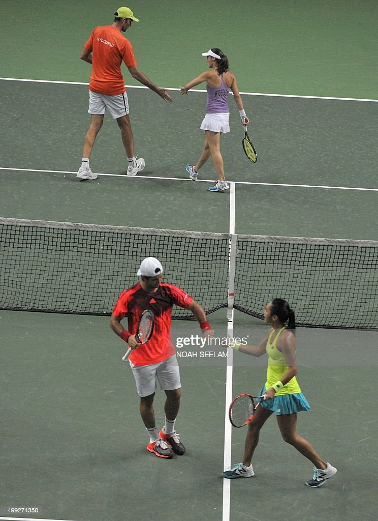 Switzerland's Martina Hingis and partner Croatia's Ivo Karlovic of Hyderabad Aces gesture during a mixed doubles match against Britain's Heather...