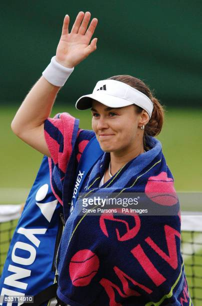 Switzerland's Martina Hingis celebrates her victory over Great Britain's Naomi Cavaday during The All England Lawn Tennis Championship at Wimbledon