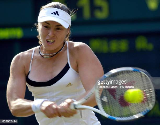 Switzerland's Martina Hingis in action against Japan's Ai Sugiyama during the third round of The All England Lawn Tennis Championships at Wimbledon