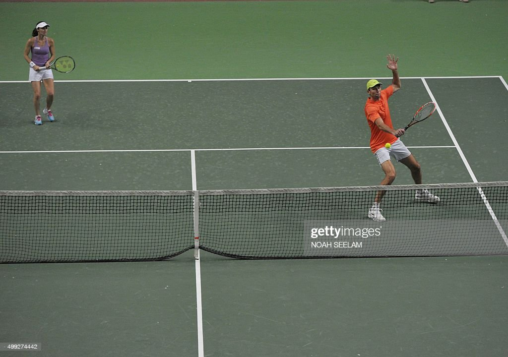 Switzerland's Martina Hingis looks on as partner Croatia's Ivo Karlovic of Hyderabad Aces plays a shot during a mixed doubles match against Britain's...
