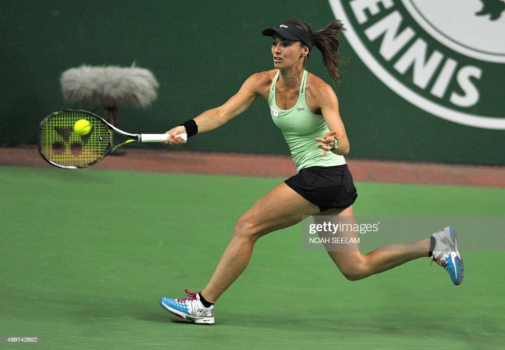 Switzerland's Martina Hingis of Hyderabad Aces plays a shot against Serbian's Jelena Jankovic of Nagpur Orangers during her women's singles match at...
