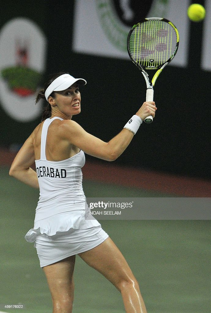 Switzerland's Martina Hingis of Hyderabad Aces plays a shot during her women's singles match against Poland's Agnieszka Radwanska of Pune Marathas at...