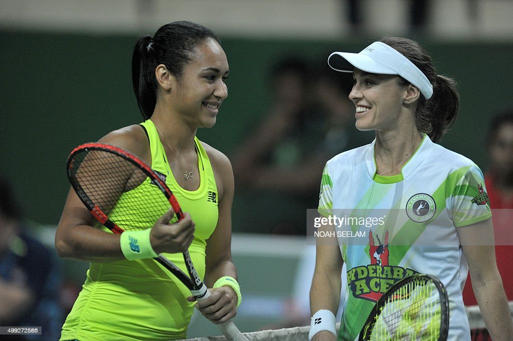 Switzerland's Martina Hingis of Hyderabad Aces poses with Britain's Heather Watson of Chennai Warriors prior to the women's singles match at the...