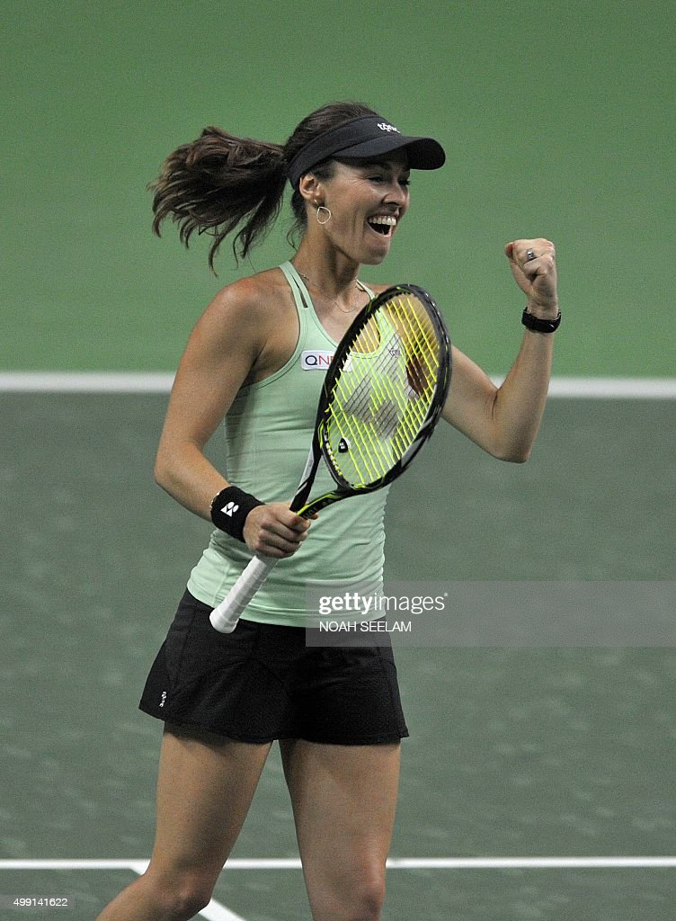 Switzerland's Martina Hingis of Hyderabad Aces reacts after winning a point against Serbian's Jelena Jankovic of Nagpur Orangers during her women's...