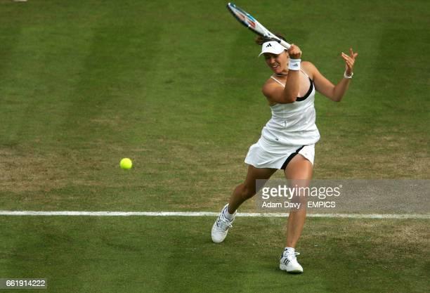 Switzerland's Martina Hingis plays a volley at the net against Ai Sugiyama