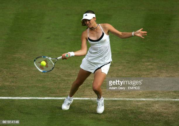 Switzerland's Martina Hingis plays a volley at the net