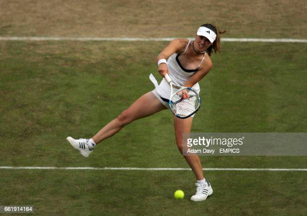 Switzerland's Martina Hingis plays a volley during her game against Japan's Ai Sugiyama
