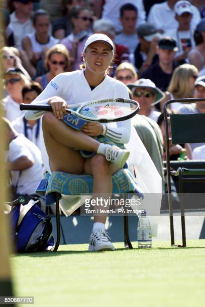 Switzerland's Martina Hingis shows her dissapointment fter losing to Spain's Virginia Ruano Pascual in the First Round match of the Lawn Tennis...