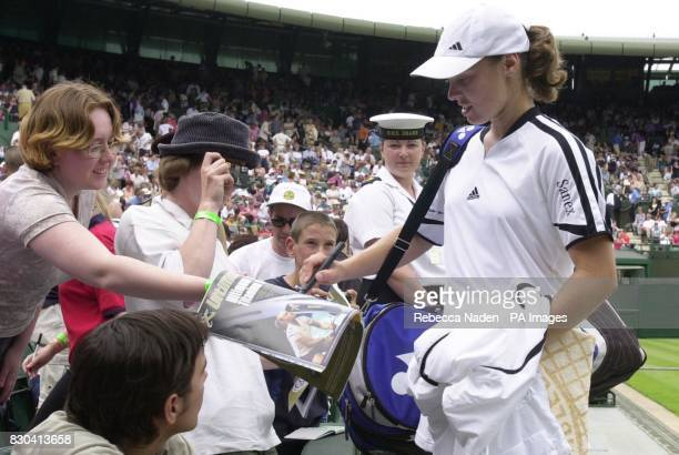 Switzerland's Martina Hingis signs autographs after her 6/1 6/2 victory over Anke Huber of Germany during the Lawn Tennis Championships at Wimbledon
