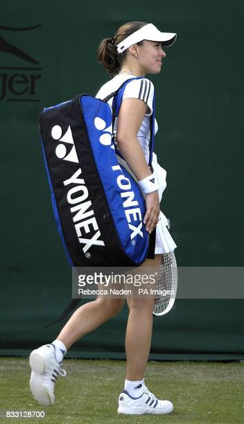 Switzerland's Martina Hingis smiles to the crowd as she walks off court following her defeat to USA's Laura Granville during The All England Lawn...