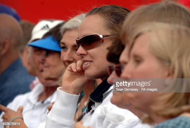 Switzerland's Martina Hingis watches USA andy Roddick from the stands during the Artois Championships at The Queen's Club London