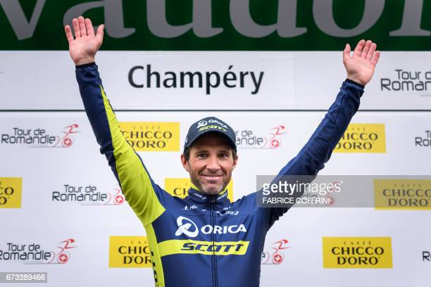 Switzerland's Michael Albasini of Team OricaScott celebrates his stage's victory during the podium ceremony of the first stage of Tour de Romandie...