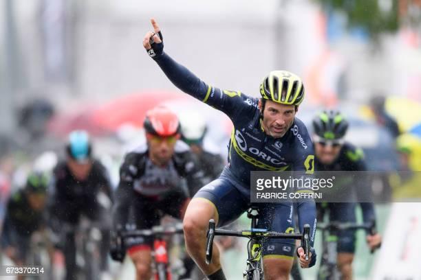 Switzerland's Michael Albasini of Team OricaScott celebrates winning the first stage of the CYC Tour de Romandie UCI protour cycling race a 173km...