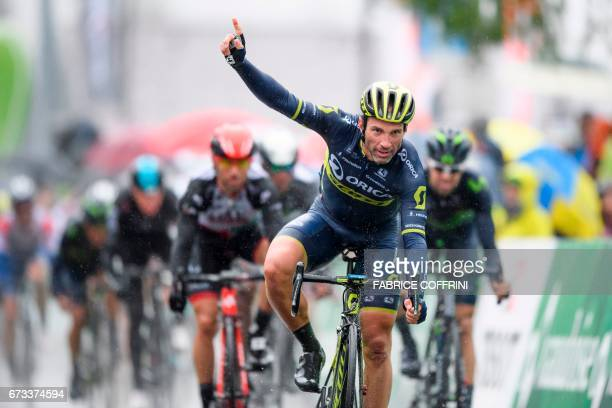 Switzerland's Michael Albasini of Team OricaScott recats as he crosses the finish line to win the first stage of Tour de Romandie UCI protour cycling...