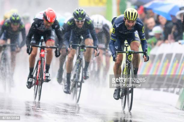Switzerland's Michael Albasini of Team OricaScott sprints to win the first stage of Tour de Romandie UCI protour cycling race a 173km ride from Aigle...