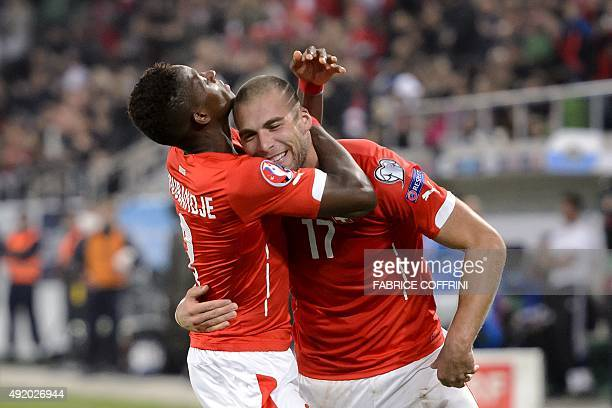 Switzerland's midfiedler Pajtim Kasami celebrates with Switzerland's midfielder Francois Moubandje after scoring a goal during the Euro 2016...