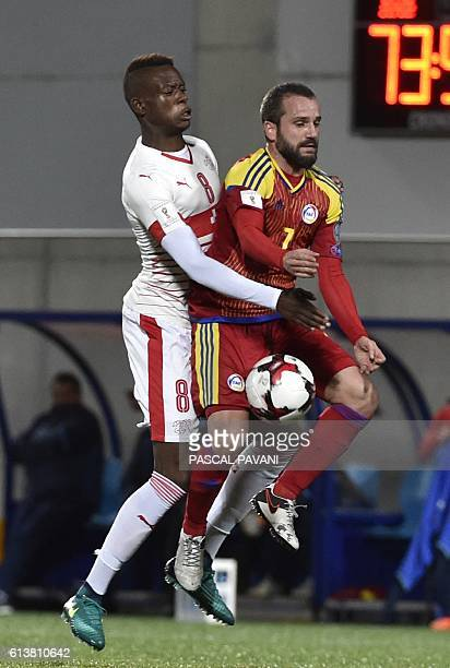 Switzerland's midfielder Denis Zakaria vies with Andorra's defender Marc Pujol during the FIFA World Cup 2018 football qualifier between Andorra and...