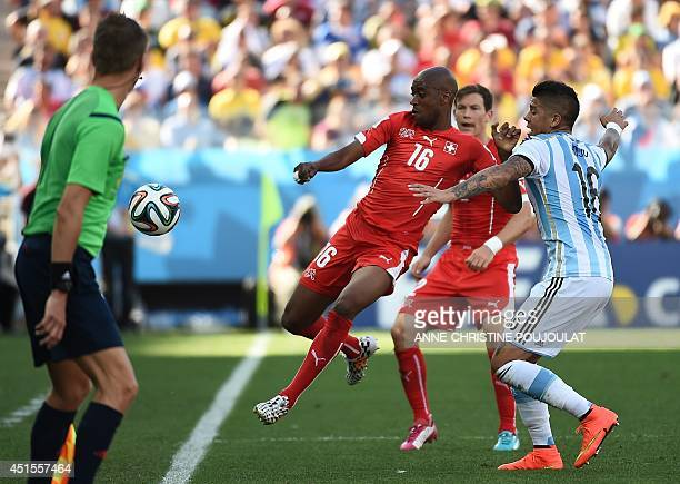 Switzerland's midfielder Gelson Fernandes and Argentina's defender Marcos Rojo vie for the ball during the Round of 16 football match between...