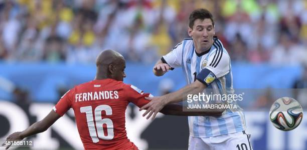 Switzerland's midfielder Gelson Fernandes and Argentina's forward and captain Lionel Messi vie for the ball during a Round of 16 football match...