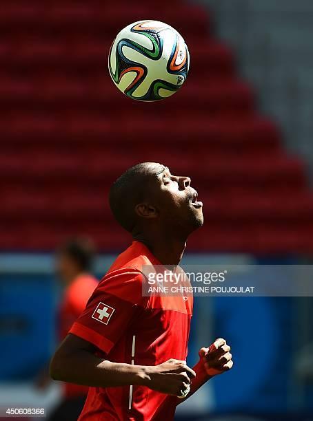 Switzerland's midfielder Gelson Fernandes controls the ball during a team training session at The Mane Garrincha National Stadium in Brasilia on June...