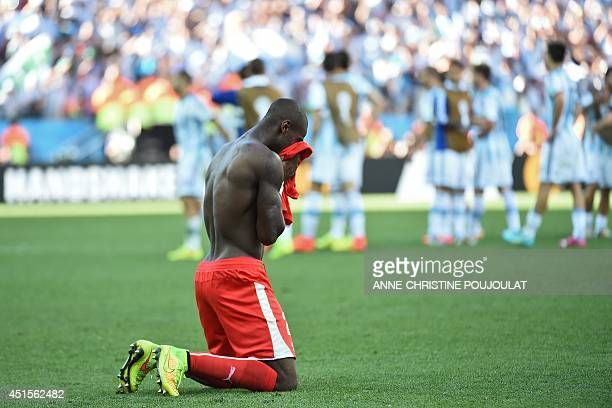 Switzerland's midfielder Gelson Fernandes reacts after losing their Round of 16 football match between Argentina and Switzerland at the Corinthians...