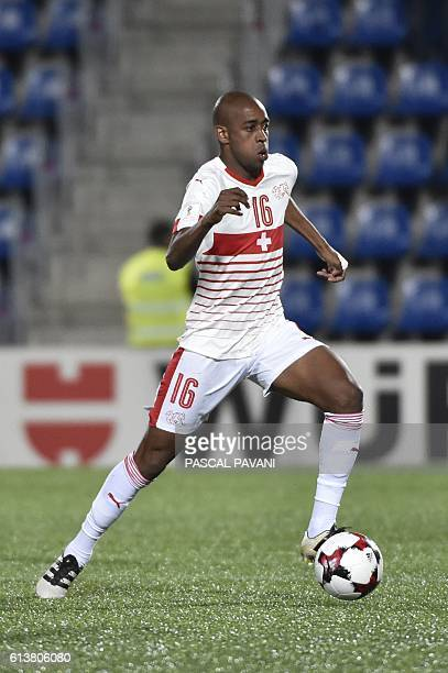 Switzerland's midfielder Gelson Fernandes runs with the ball during the FIFA World Cup 2018 football qualifier between Andorra and Switzerland on at...